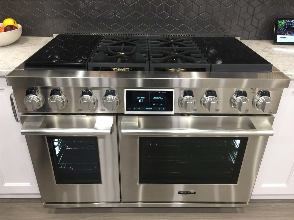 "48"" kitchen range by Signature Kitchen Suite with sous-vide cooker and induction cooking in a dual fuel range #sousvide #range #kitchendesign #kitchenappliances"