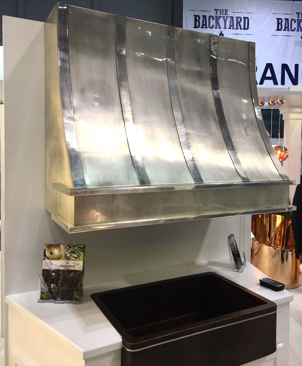Beautiful metallic handmade kitchen hood by Thompson Traders #kitchenhood #customhood #venthood