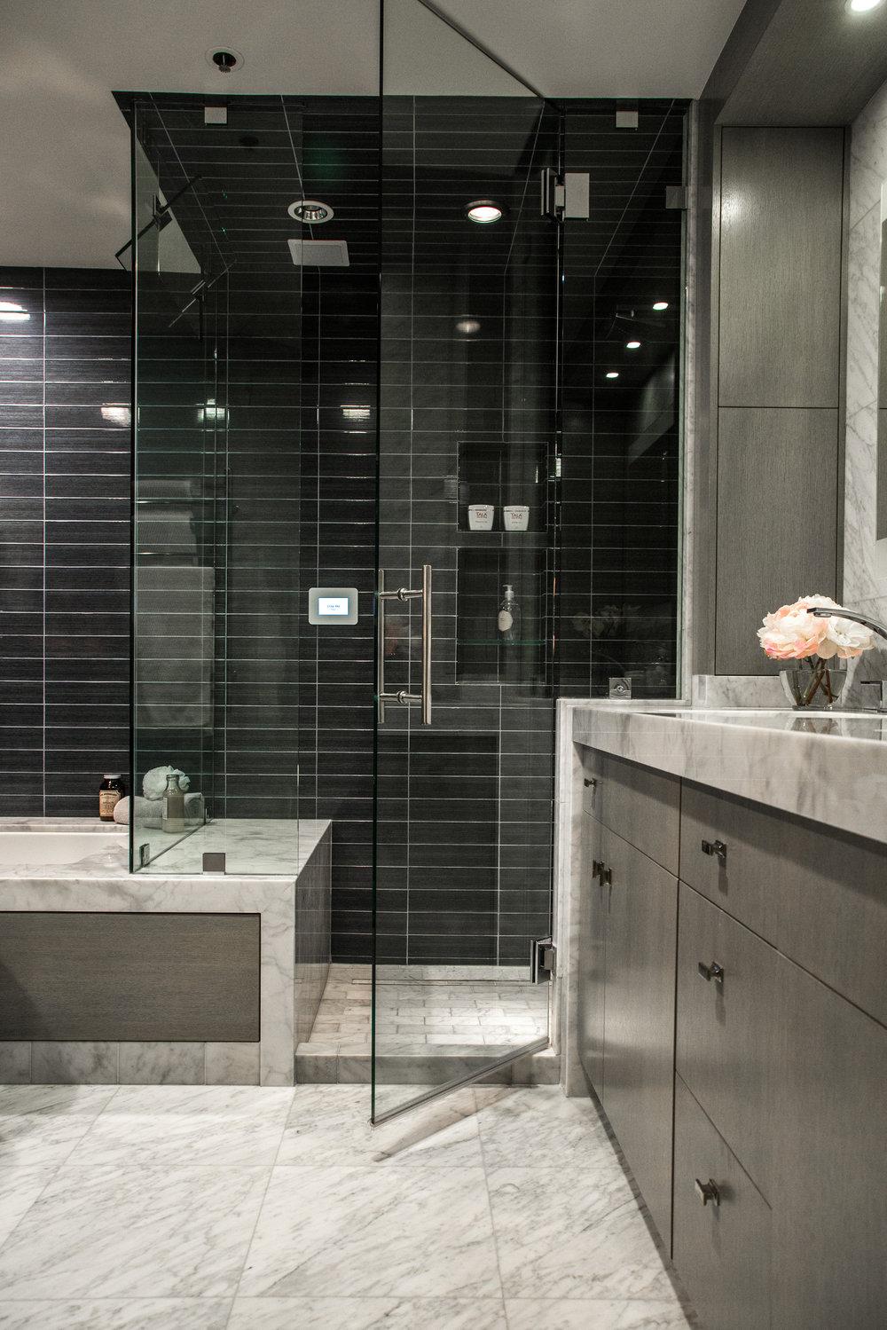 Steam shower designed in luxury bathroom by Designer: Lori Gilder #steamshower #blacktile #bathroomremodel
