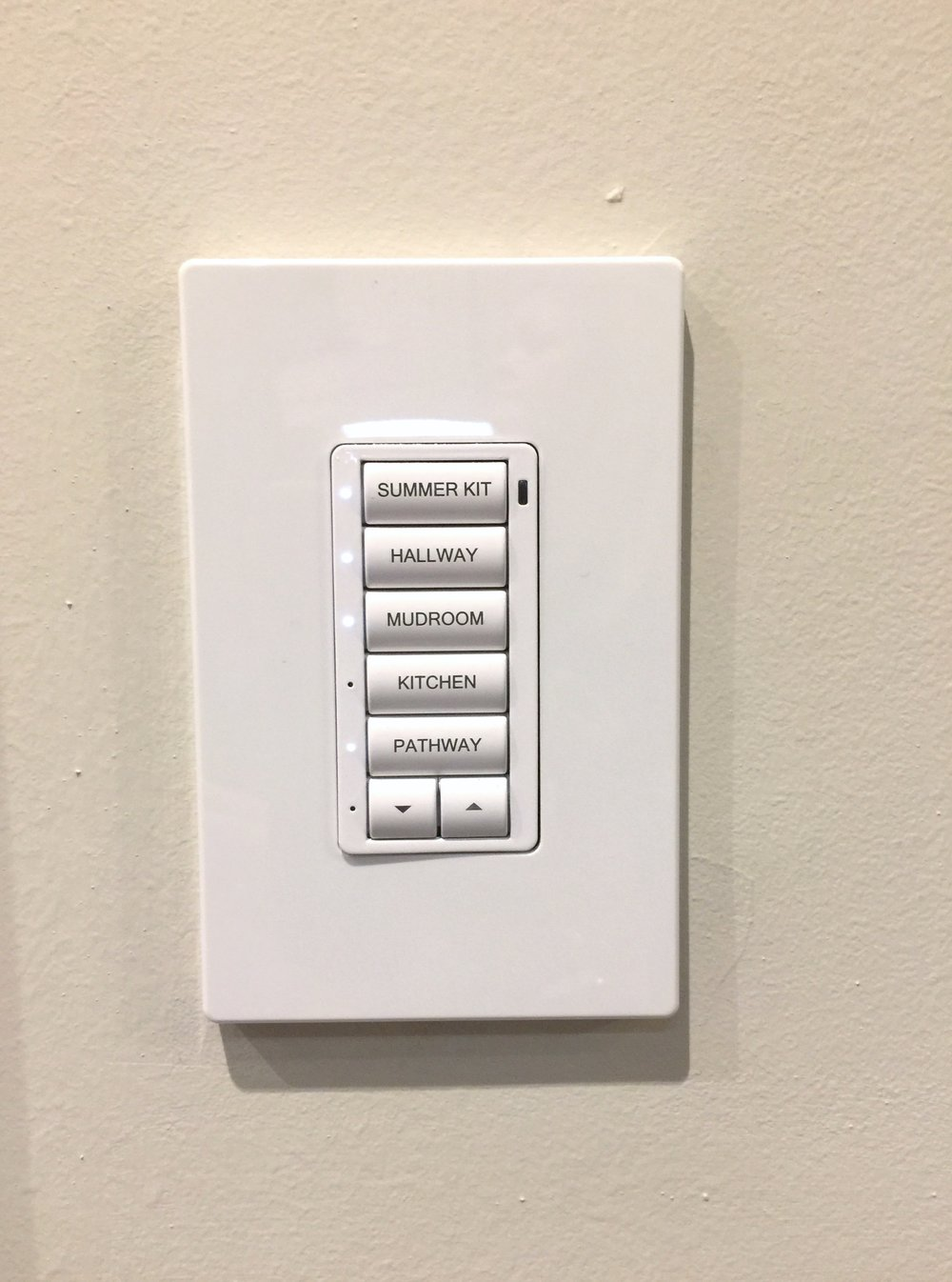 Legrand switches were labeled and all stacked into one single switch plate. :-)Kitchen in The New American Remodel - Orlando, KBIS #lightswitch