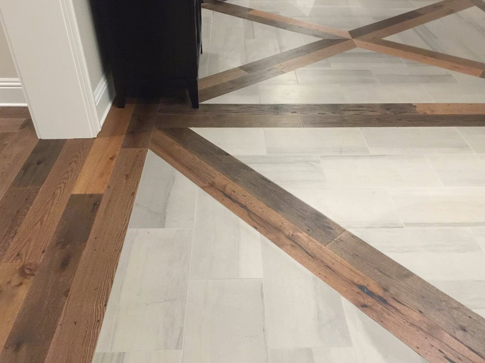 Wood flooring transition to wood/tile inset in loggia - The New American Remodel - Orlando, KBIS2018