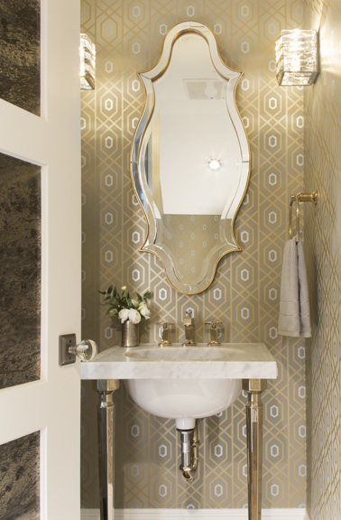 I've used this lovely wallpaper before in a bathroom. Perfect blend of silver and gold. Powder room under the stairs in The New American Remodel. #powderroom
