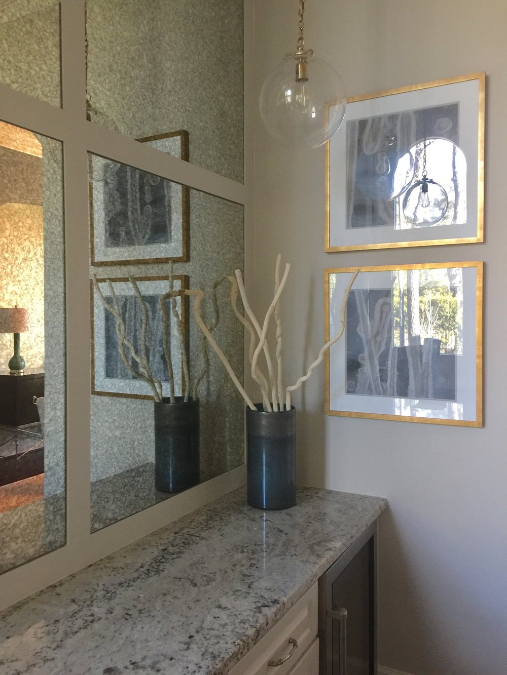 After - Remodeled  bar area with new antique mirrored panels, pendant lighting, and artwork #bar #mirror #paneling #mirrorpanels