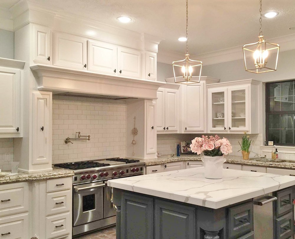 AFTER - Partial kitchen remodel with new island marble countertop and new backsplash #whitekitchen #marblecountertop #beforeandafterkitchen