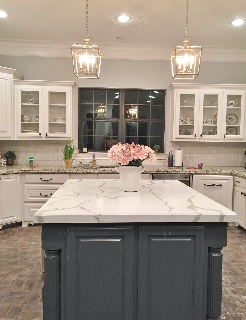 AFTER - The impact of the new simple backsplash that blended with the upper cabinets made the kitchen look more up to date and minimized the spotty granite perimeter counters. #whitemarble #marblecountertop #kitchenremodel
