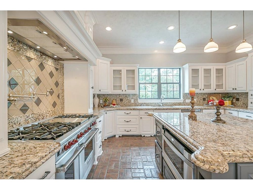 BEFORE - This homeowner wanted to reduce the look of the spotty granite in her kitchen without redoing everything.