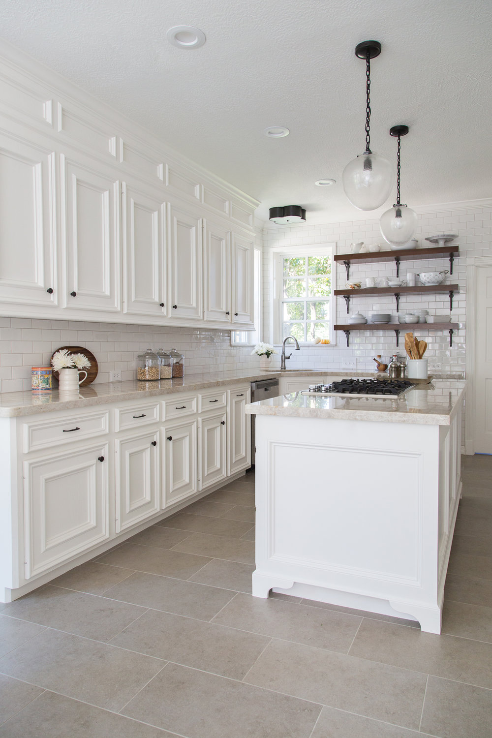 White kitchen remodel with open wood shelves - Designer: Carla Aston, Photographer: Tori Aston #whitekitchen #openshelving #quartzitecountertops