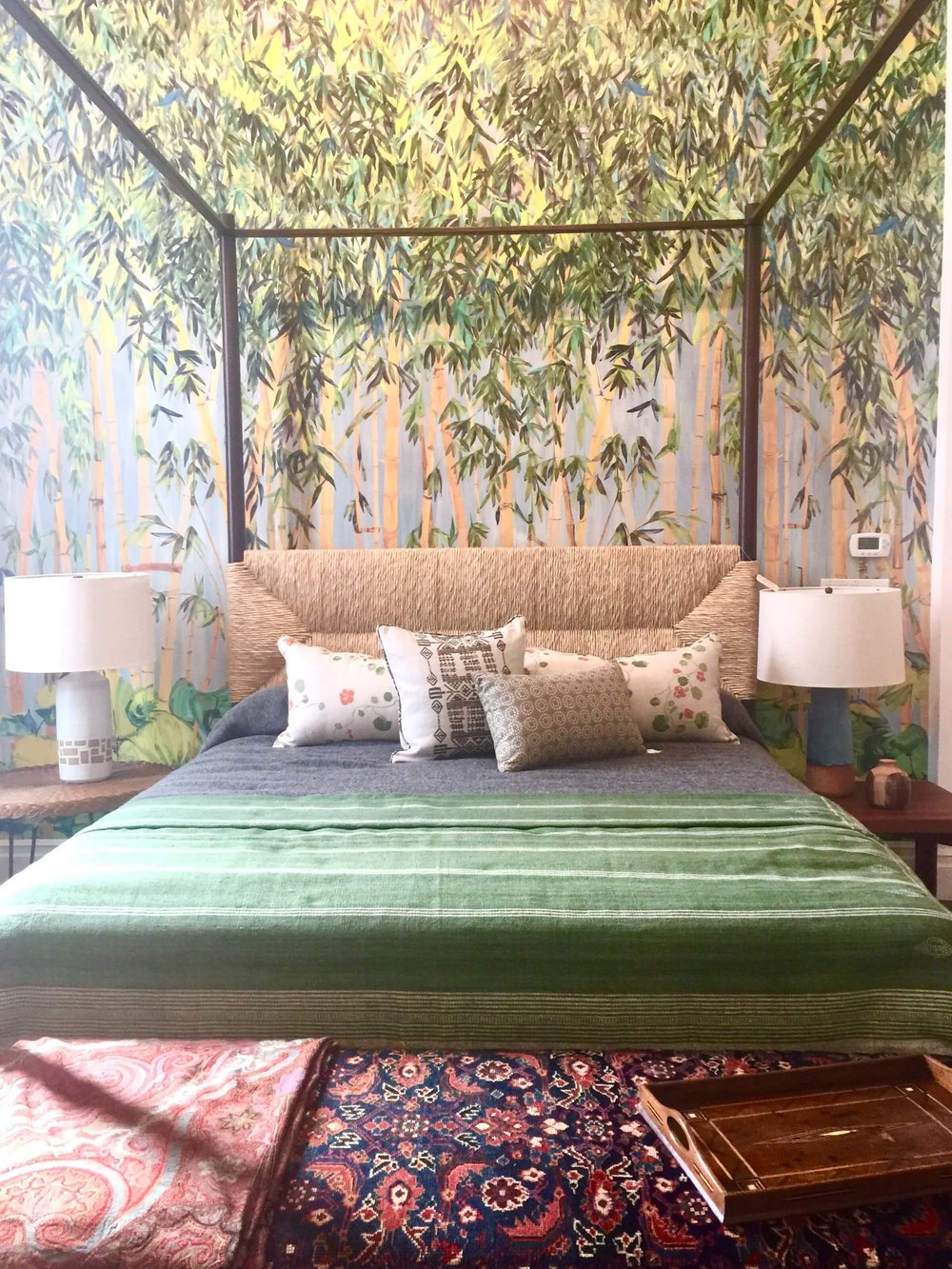 Four poster bed with rush headboard and bamboo patterned wall mural at Hollywood at Home, Los Angeles home furnishings shop #bedroom #fourposterbed