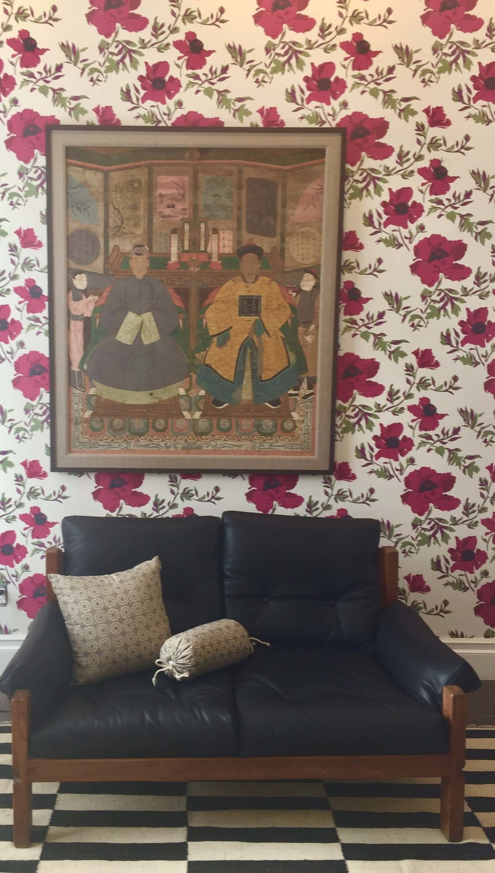 Hollywood at Home, Los Angeles home furnishings shop with floral wallpaper and black leather vintage sofa #floralwallpaper #leathersofa #vintagesofa