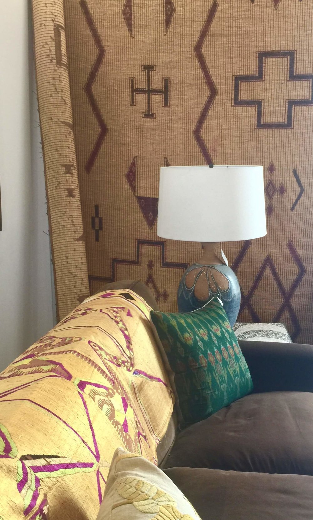 Vintage rugs, handmade ceramic lamps and colorful pillows in Hollywood at Home, Los Angeles home furnishings shop #vintagerug #decoratingideas