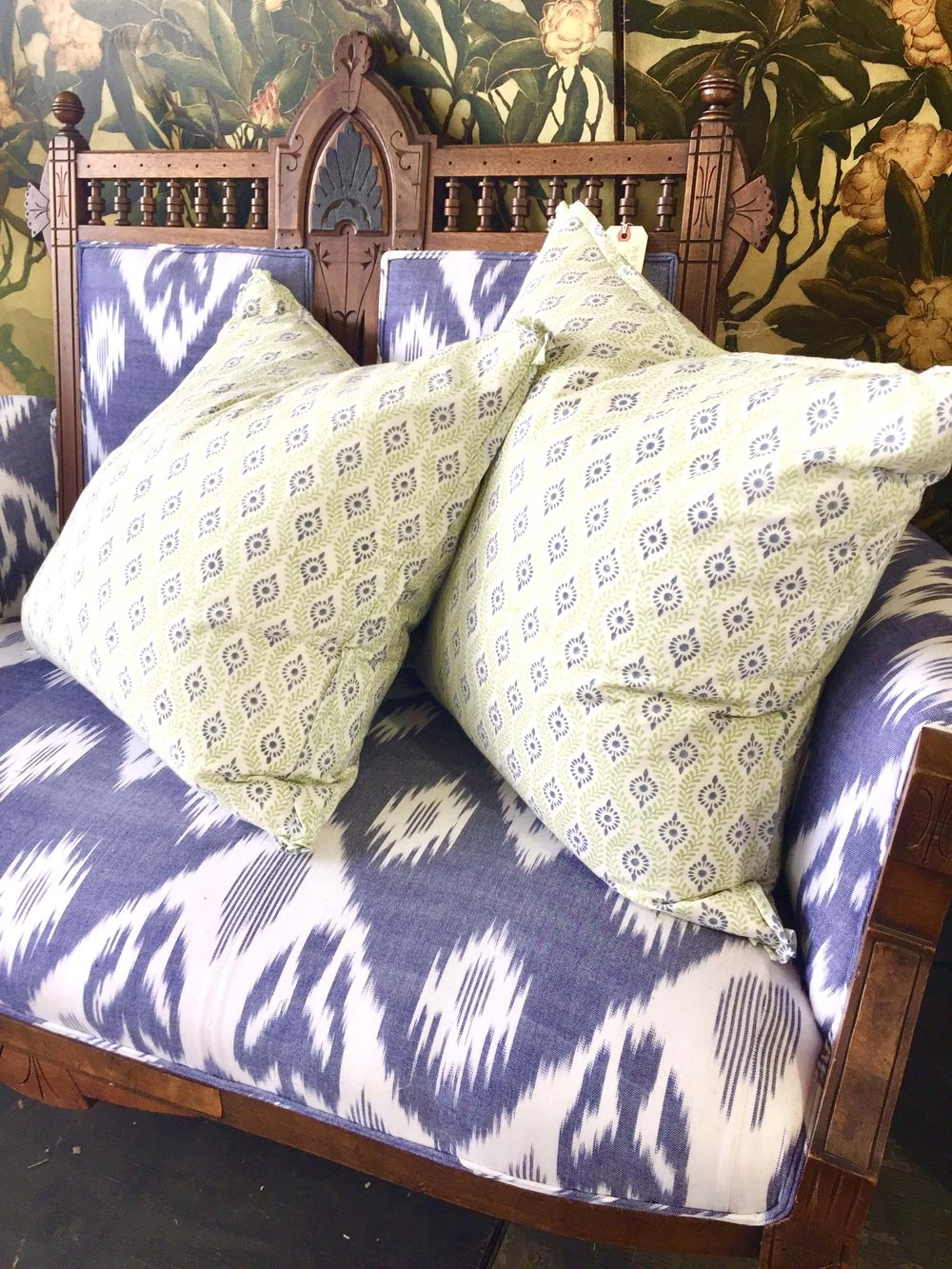 Cotton print textiles made into pillows and upholstered goods seen at Round Top, TX at Arbor Antiques from Mela and Roam #pillows #antiques #roundtop #textiles