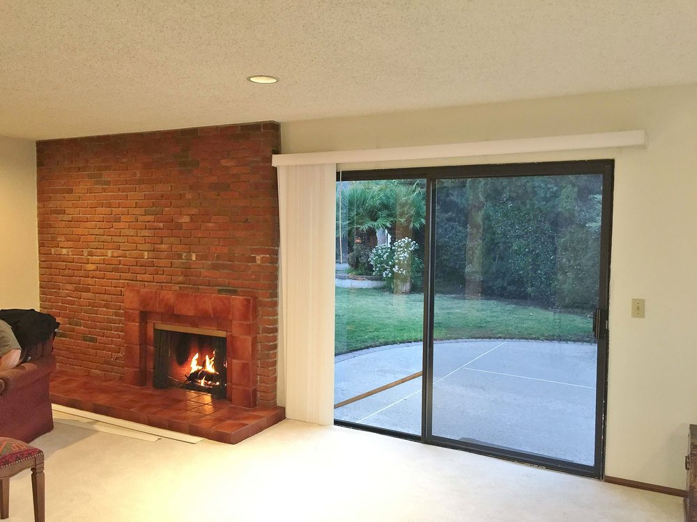 family room fireplace with sliding glass doors before remodel