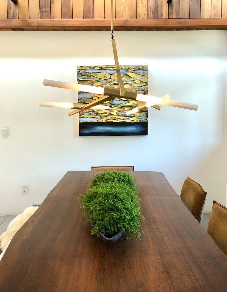 Live edge dining table in dining room w modern lighting - Assembledge+ Architects, Dwell on Design, Los Angeles, California #diningroom #pendantlighting