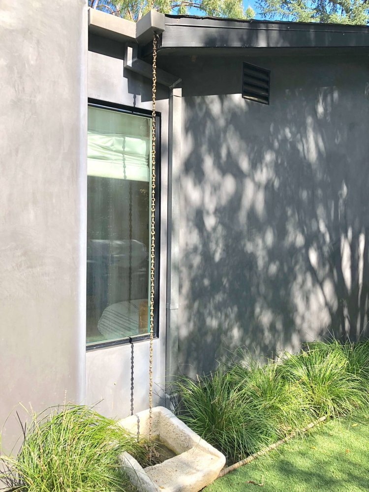 Rain chain at back of house on home tour - Assembledge+ Architects, Dwell on Design, Los Angeles, California #rainchain #backyardideas #gardenideas