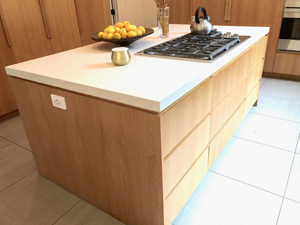 Rift cut oak cabinetry with flush mitered edge countertop | Assembledge+ Architects, Dwell on Design, Los Angeles, California #kitchenisland #riftcutoakcabinets #cabinets