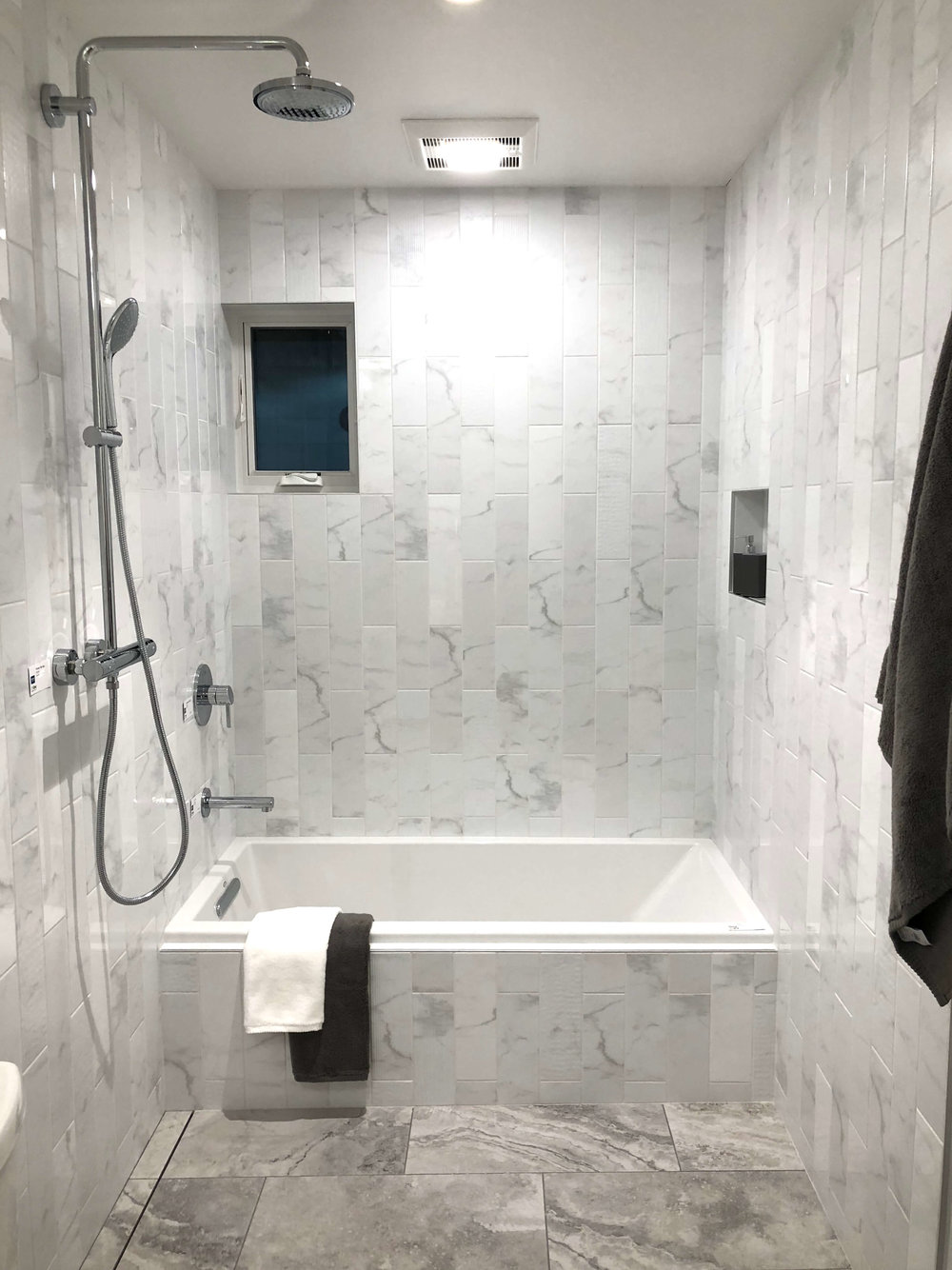 Pre-fab modular home by Method Home with marble tile luxury bathroom #prefabhome #modularhome #marbletile #marblebathroom