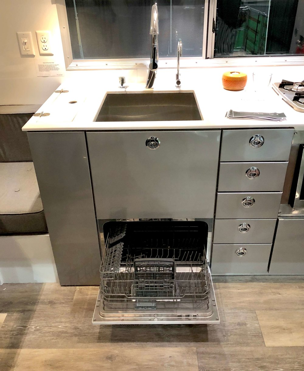 Look at this cute little dishwasher in the kitchen of this mobile home! This might make me love camping again. #glamping #camping #rv #tinyhouse
