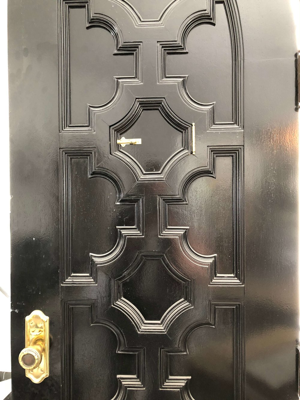 Front door was painted high gloss black with polished brass door hardware. Check out the cool speakeasy door. #blackdoor #frontdoor #brass #speakeasydoor
