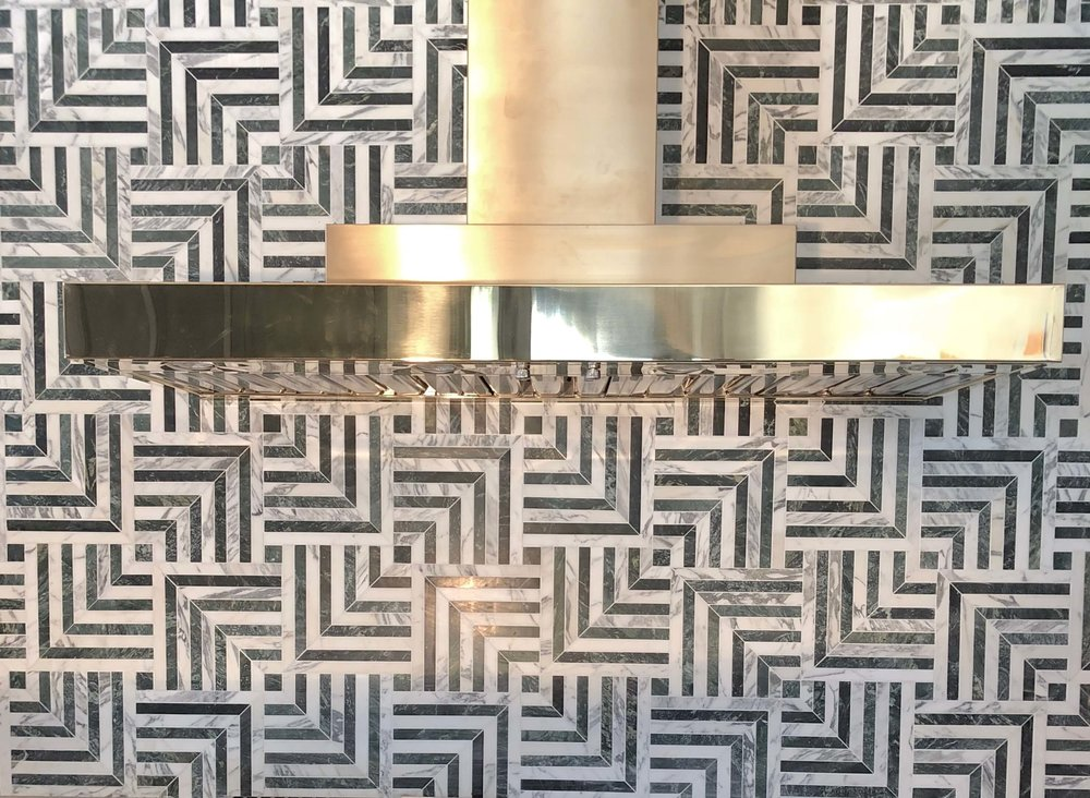 Marble mosaic tile backsplash with brass venthood - Kitchen designed by Jeanne K Chung #brass #venthood #marblemosaic #backsplash #marblebacksplash #kitchendesignideas