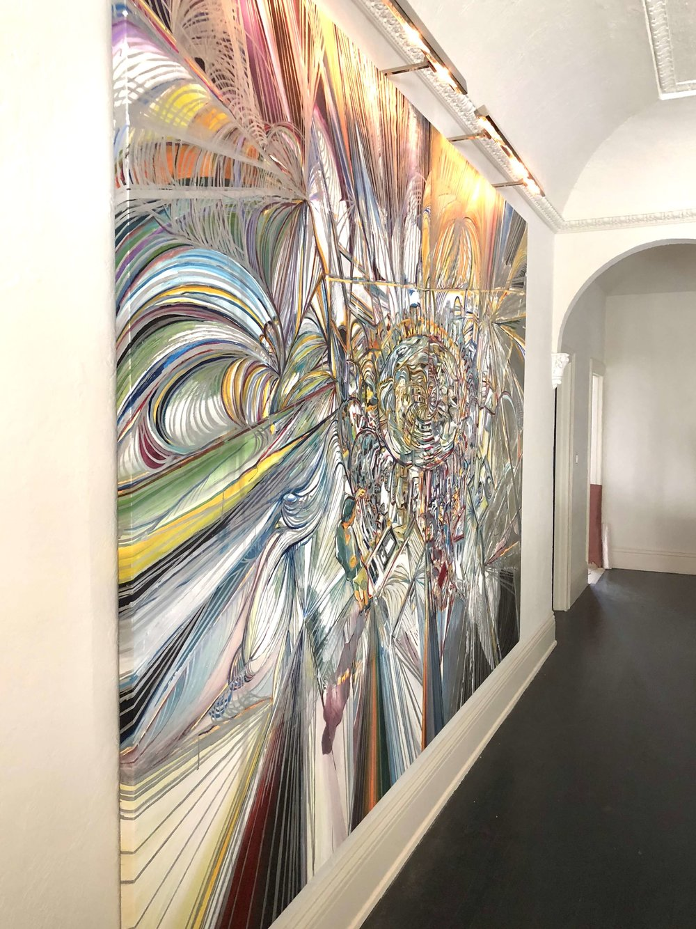 Large, oversized art by Adam Berg in upstairs hallway at Pasadena Showcase House