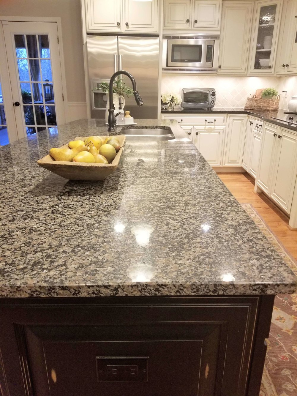 BEFORE - Spotty granite on the kitchen island