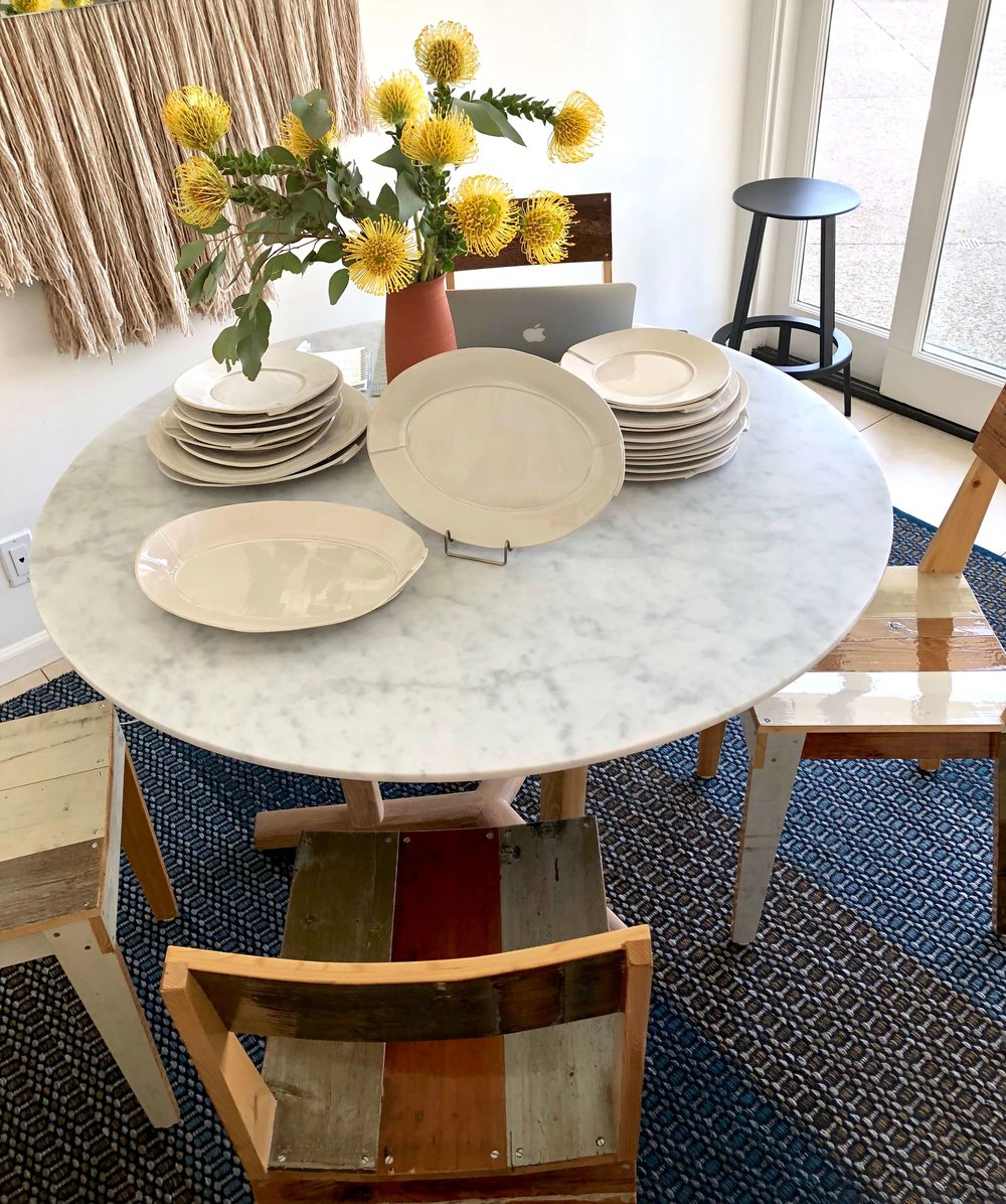White marble table top in the kitchen with handmade ceramics available for sale at Casa Perfect, Beverly Hills, CA #ceramics #marbletable