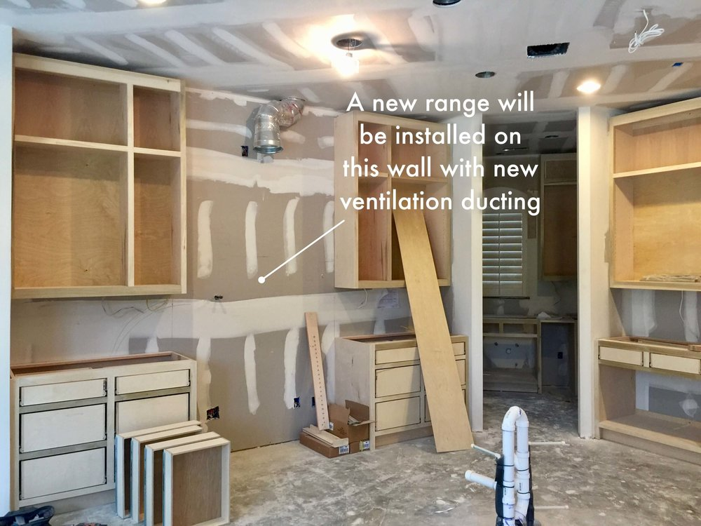Kitchen remodel under construction with new range location