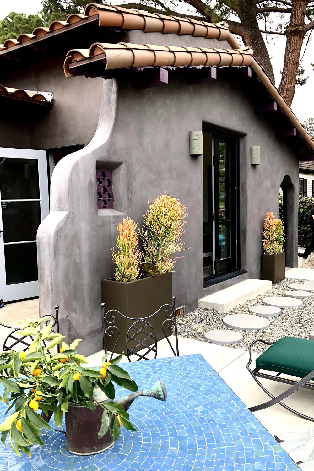 California Spanish style home gray exterior with clay tile roof and succulents #stuccoexterior #succulents #claytileroof #spanishstylehouse