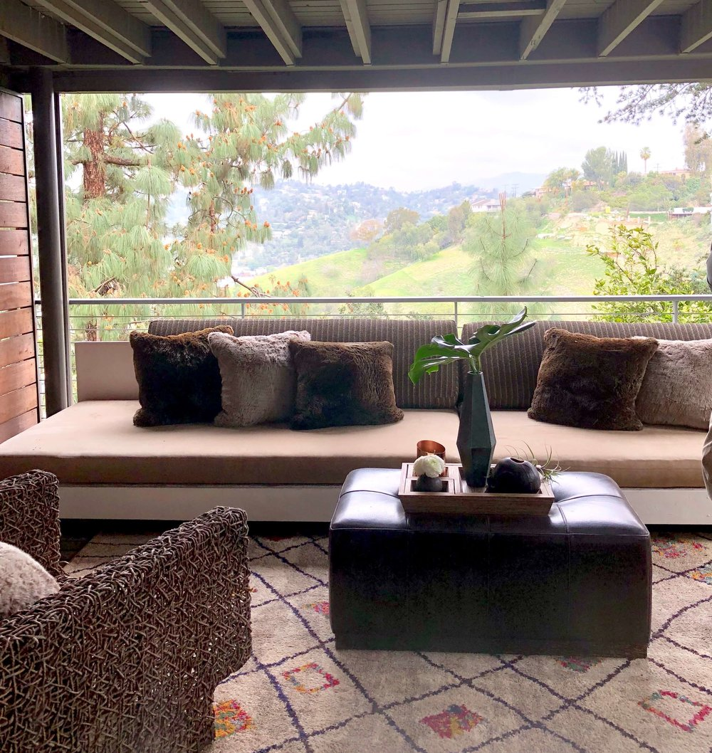 Covered outdoor room on the lower level of this California home #outdoorliving #balcony