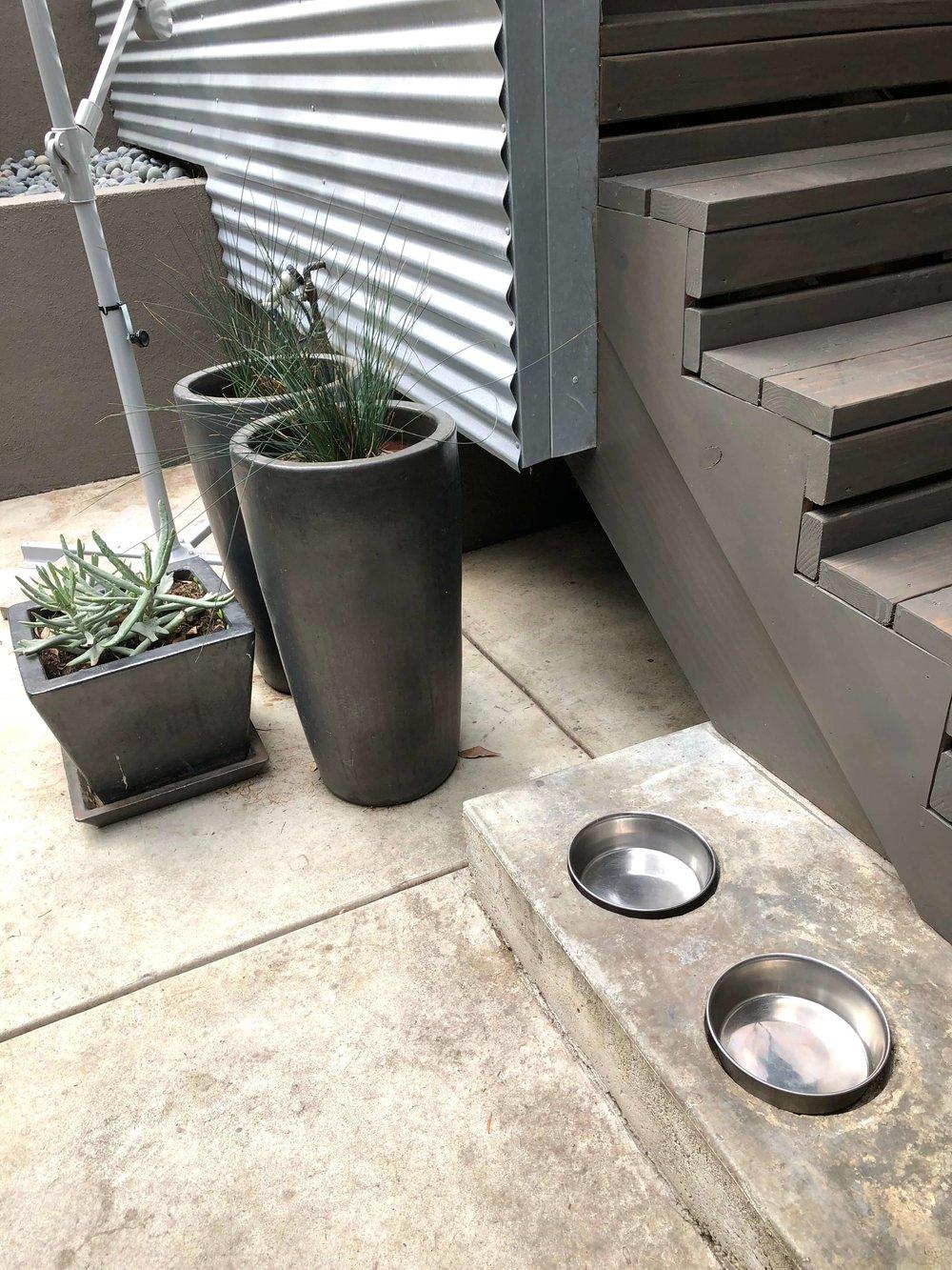 Dog bowls embedded in concrete step #designingforpets
