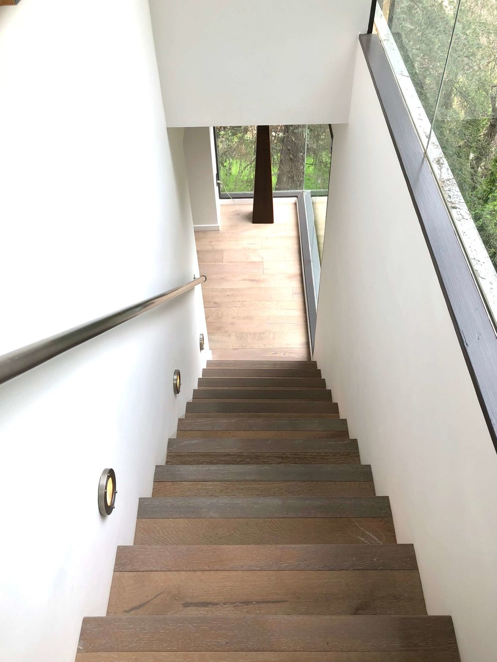 Stairs to lower level with recessed foot lighting #stair #lighting