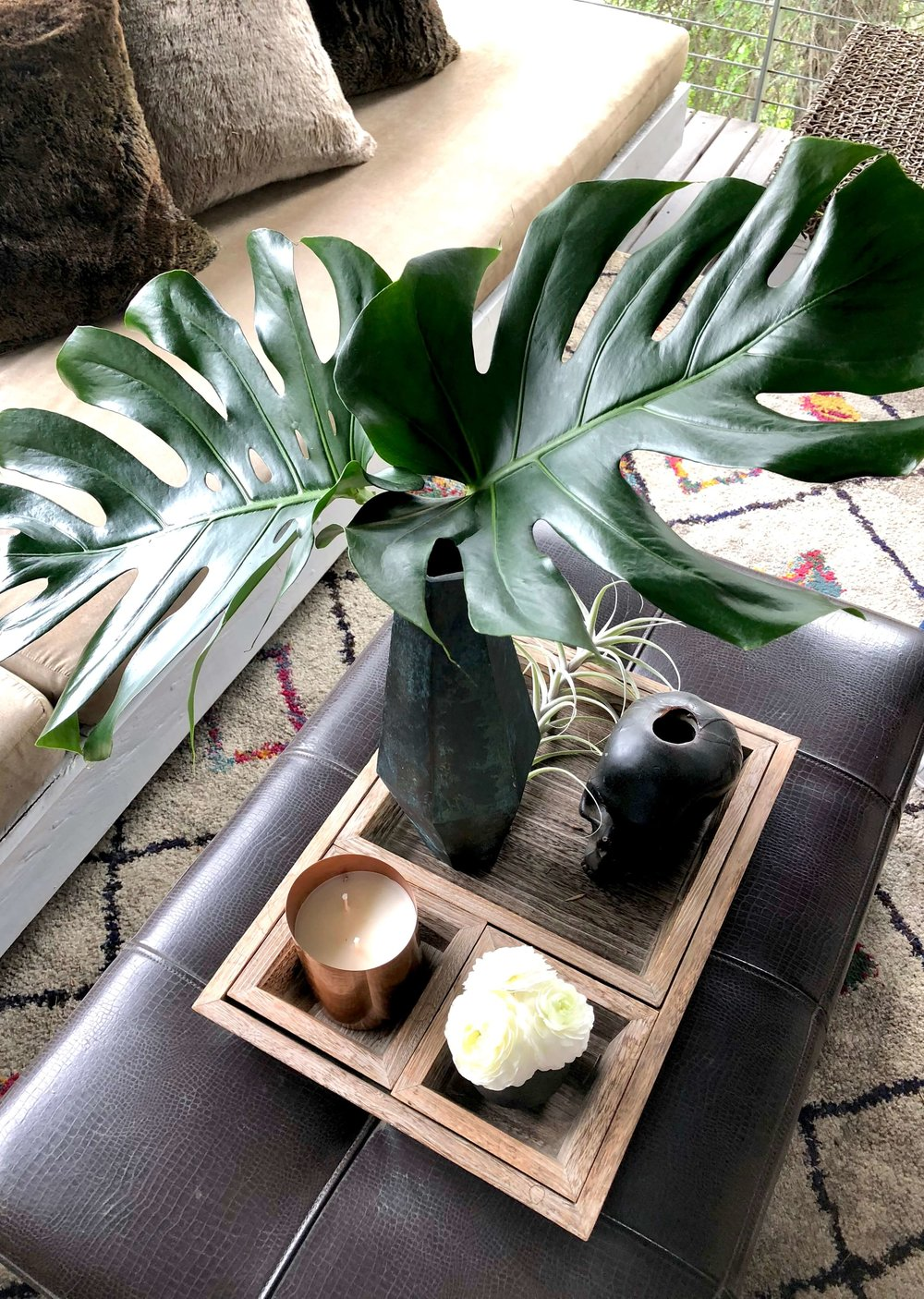 Philodendron leaves used in coffee table styling #philodendron #ottoman
