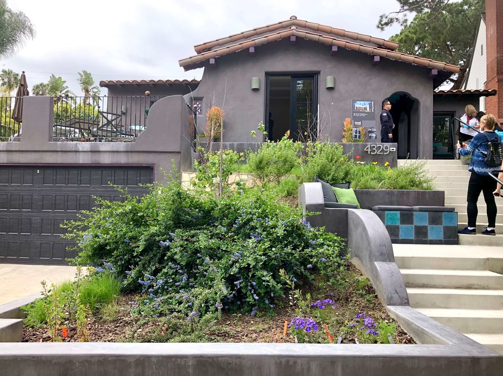 California Spanish style home gray exterior with clay tile roof and succulents  #graystucco #spanishstylehouse