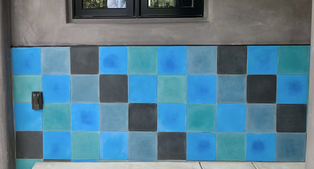 Blue and gray tiled wall at entry #concretetile #stuccoexterior