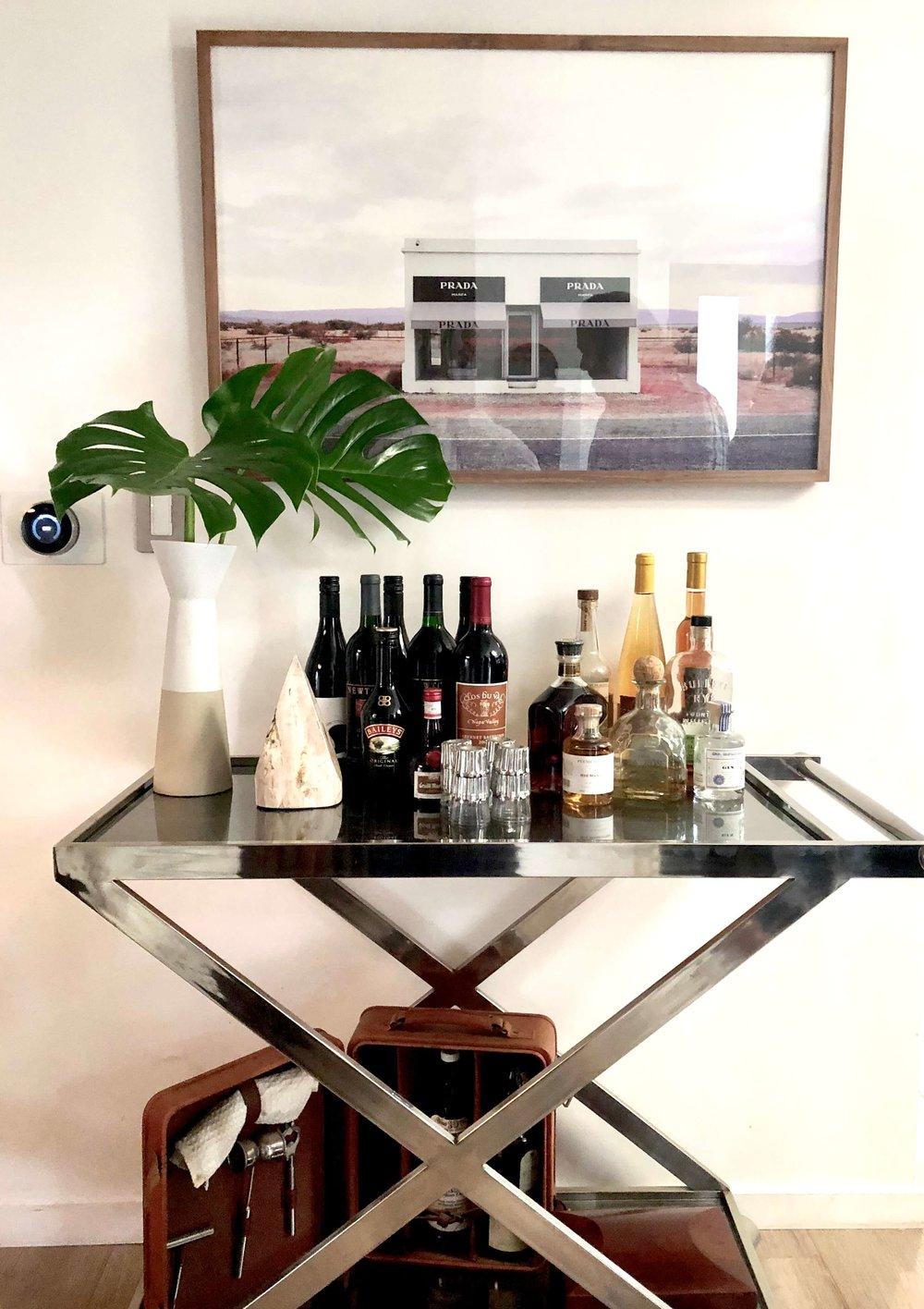 Bar cart with Gray Malin photography art above #graymalin #barcart