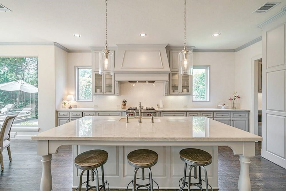 Sherwin Williams Mindful Gray was used on the cabinets in this kitchen remodel | Carla Aston, Designer #paintcolors #mindfulgray
