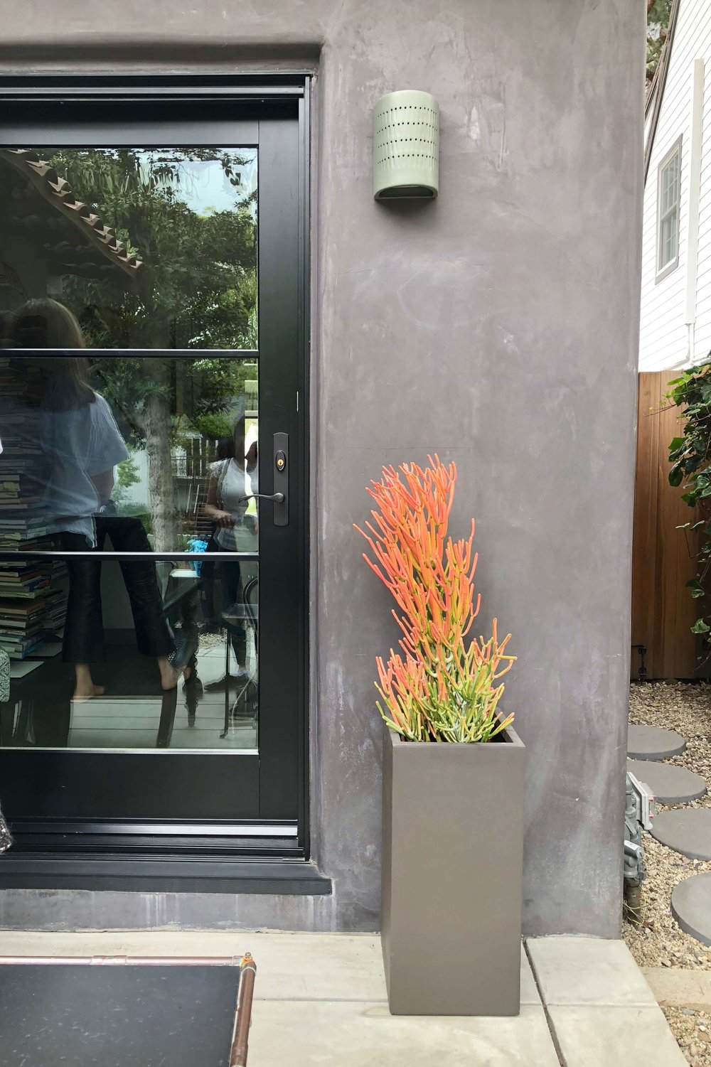 Gray stucco exterior with succulent in square planter seen on Dwell on Design home tour #succulent #graystucco