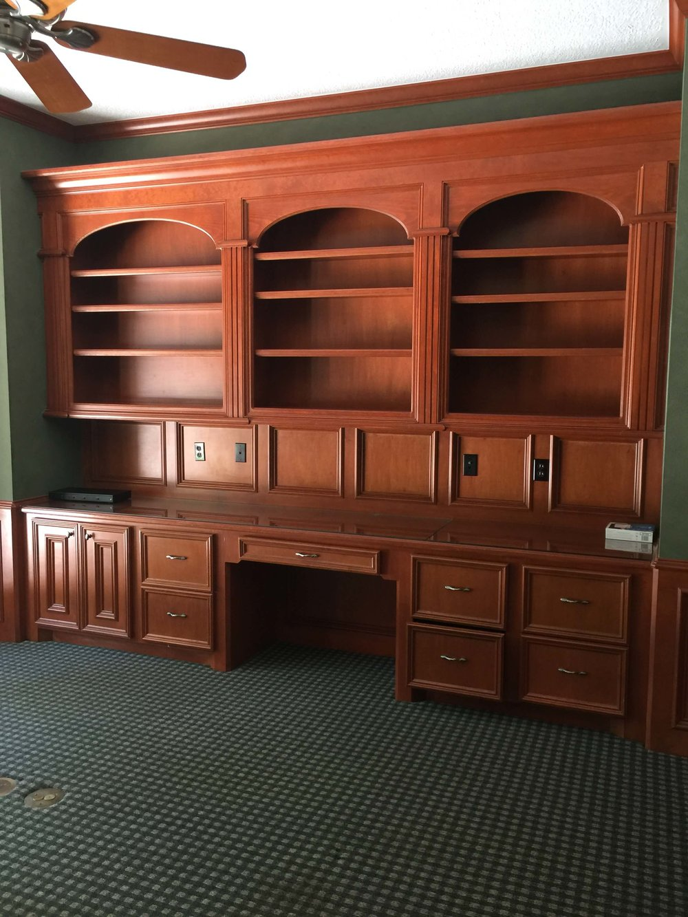 BEFORE - Home office with orange tone wood built-in