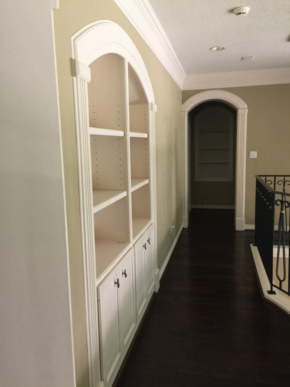 BEFORE - Upper floor hallway with built-in display shelves