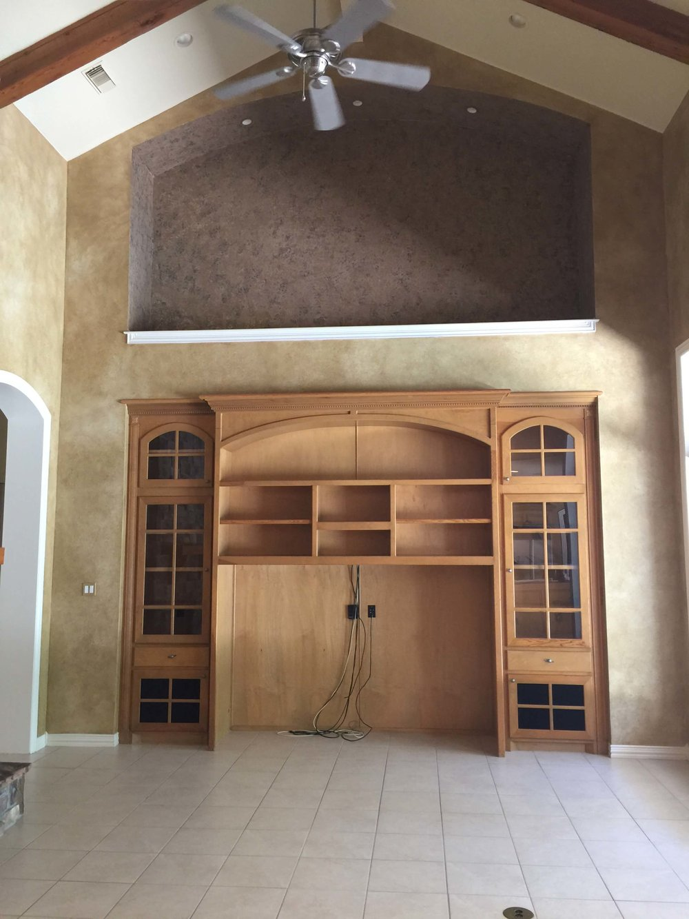 BEFORE - Family room with giant niche above tv cabinet for older model large screen tv.