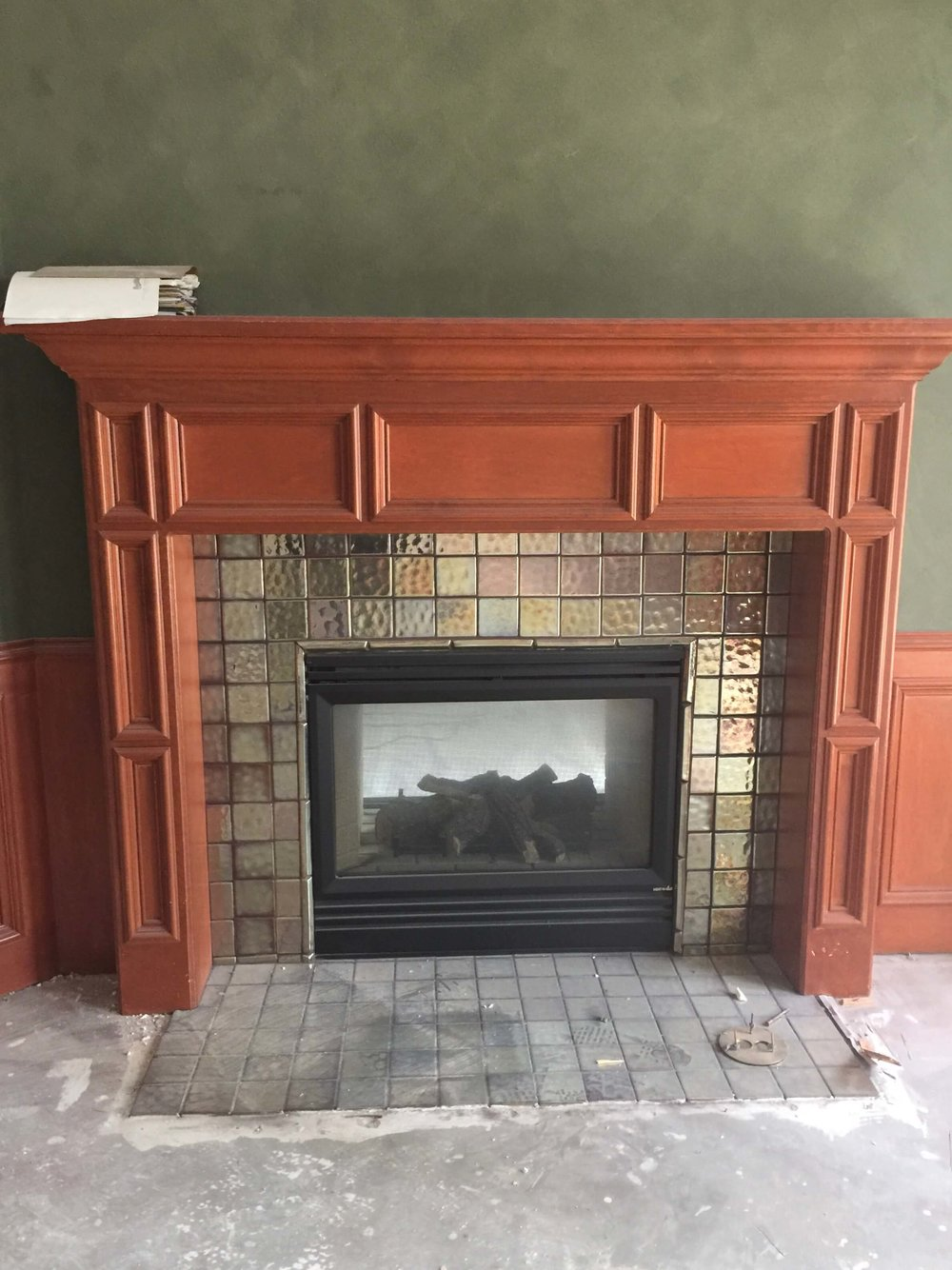 BEFORE - Home office fireplace and paneling with orange tone wood