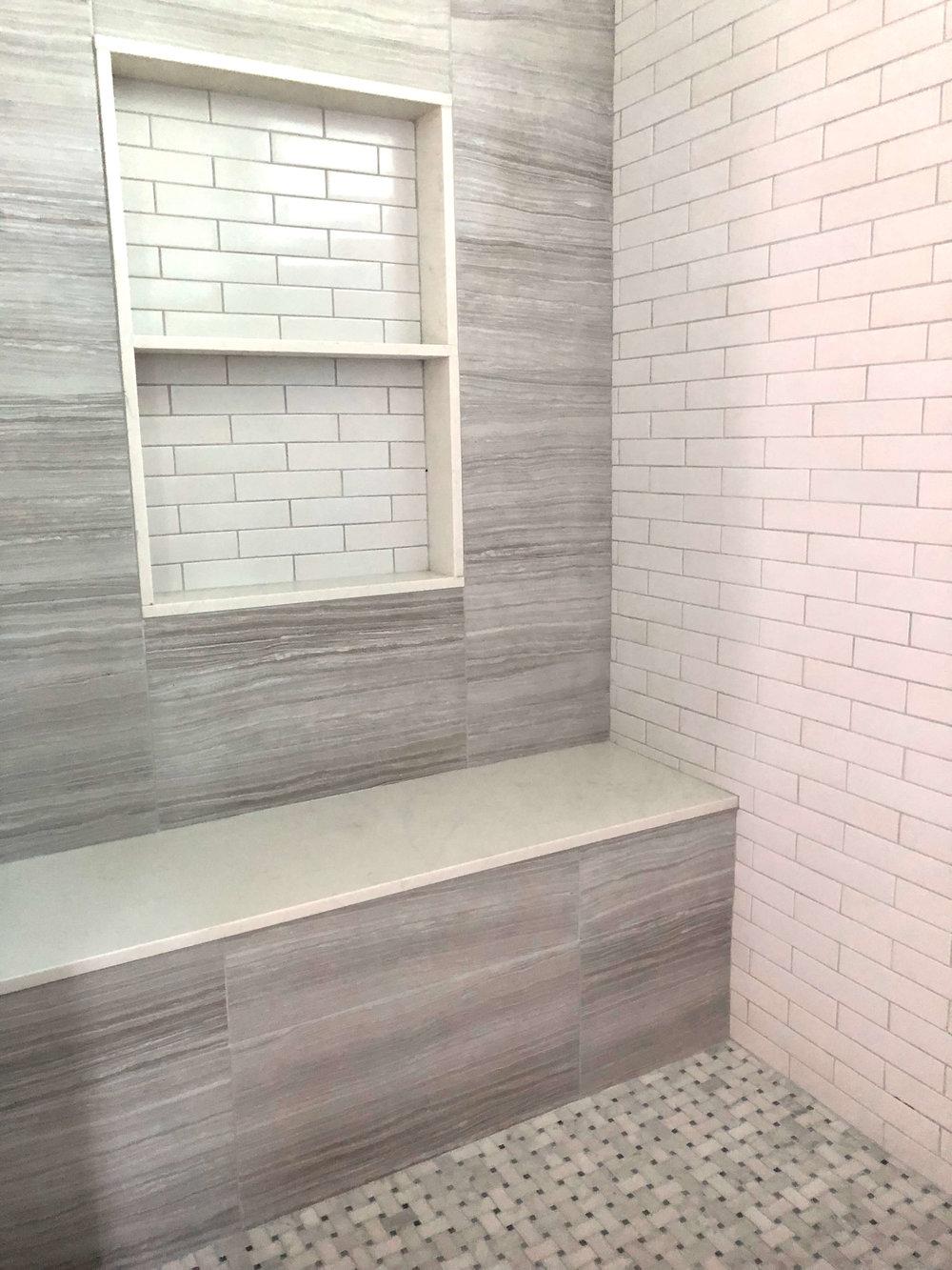 Shampoo niche and shower seat