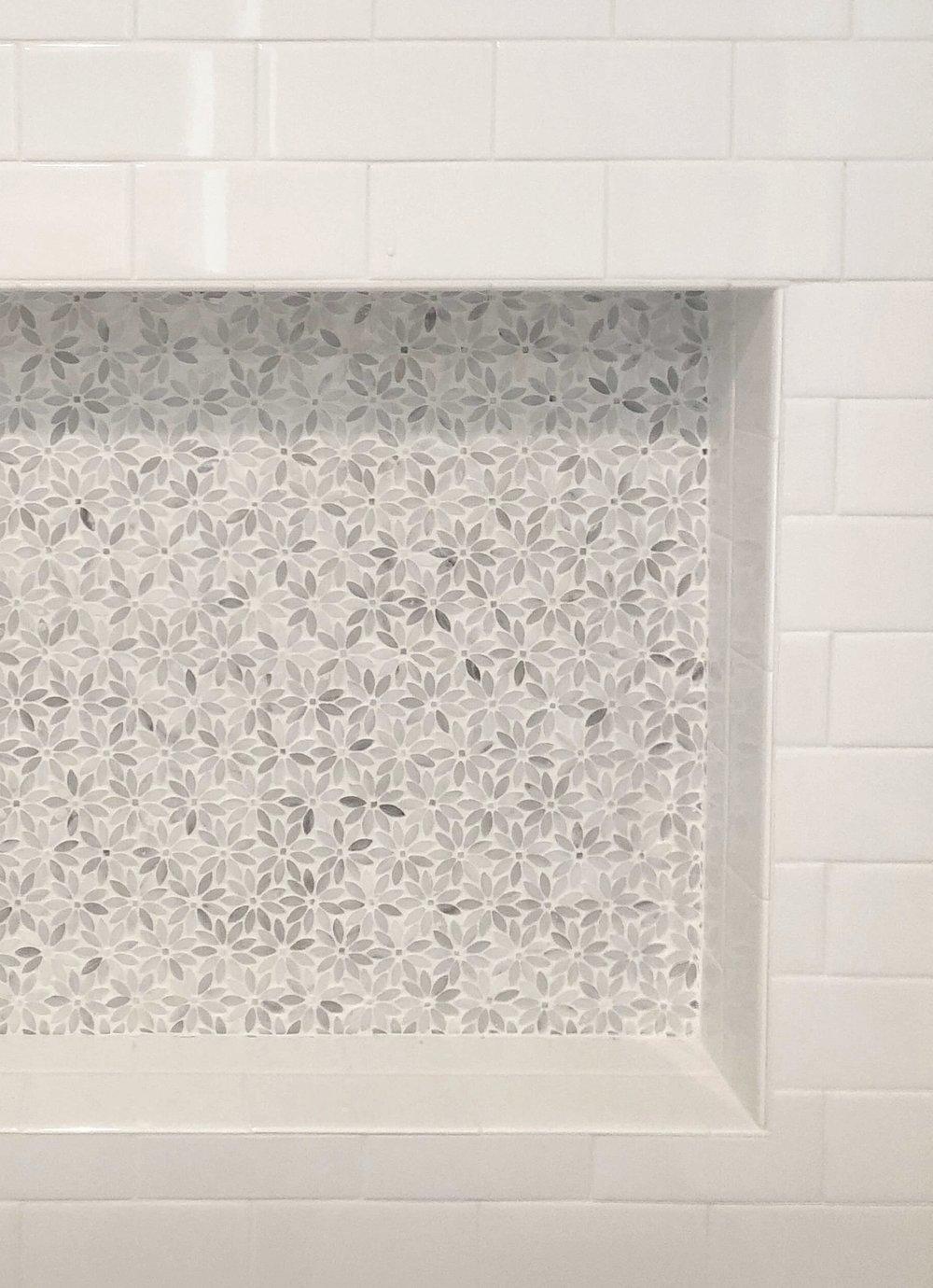 Shampoo niche with flower pattern tile