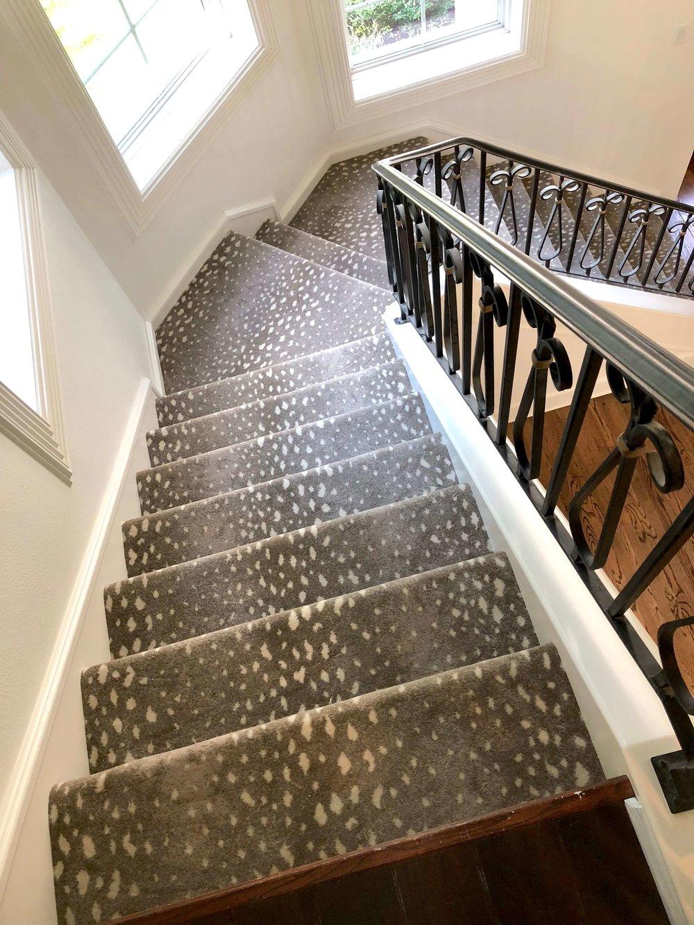 Antelope pattern carpet from Stark on the stairs | Designer: Carla Aston