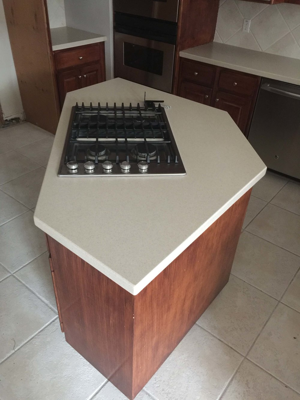 Before kitchen remodel with oddly shaped kitchen island
