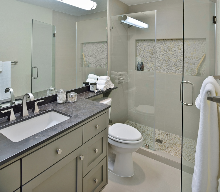 Wide mirror in bathroom runs length of vanity and toilet area | Designer: Carla Aston, Photographer: Miro Dvorscak