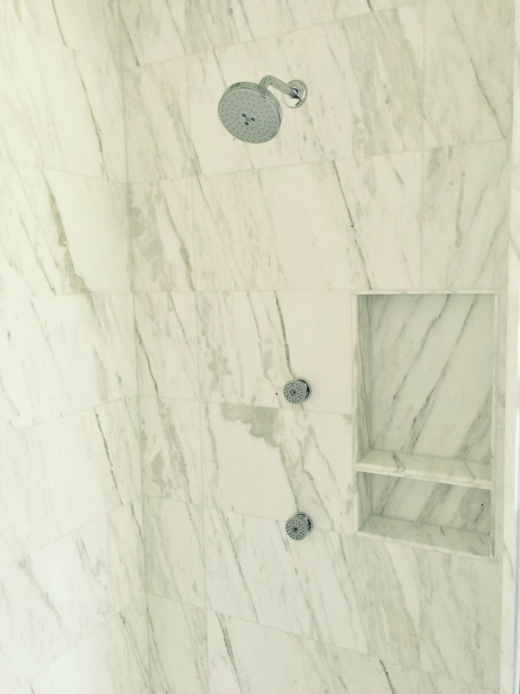 Master bath shower niche with Calacatta marble | Interior Designer: Carla Aston