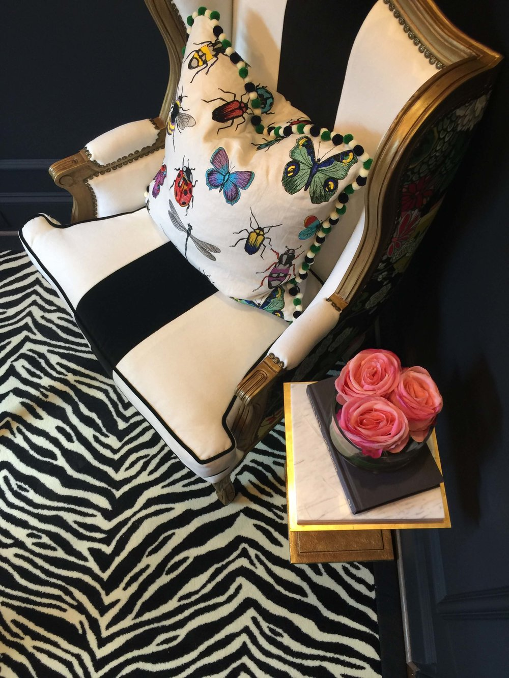 Zebra patterned rug with gold chair frame with butterfly pillow in feminine home office - Veronica Solomon Designer