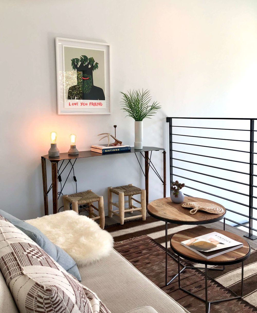 Small loft space with seating and iron railing | California home tour