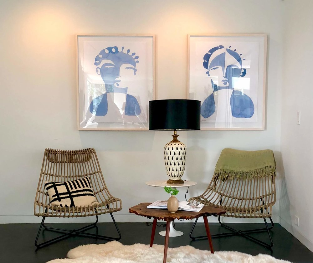 Corner at top of stairs with modern artwork and furnishings | California home tour